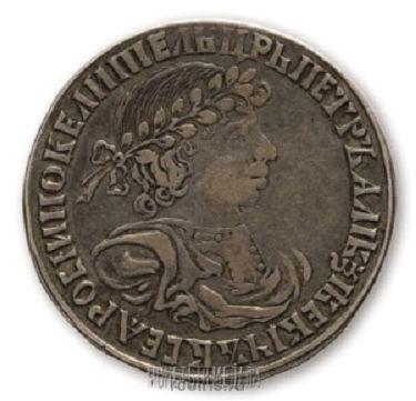 Полуполтинник 1701 года - Портрет не разделяет надпись.